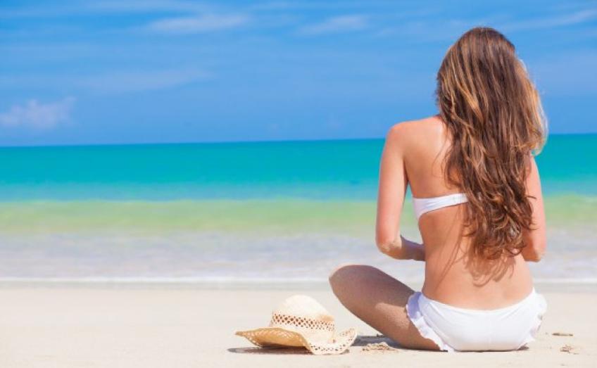 Come proteggere anche i capelli dall'esposizione solare